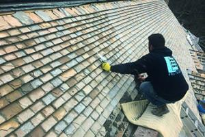 The new Collyweston roof going on to Westbury House