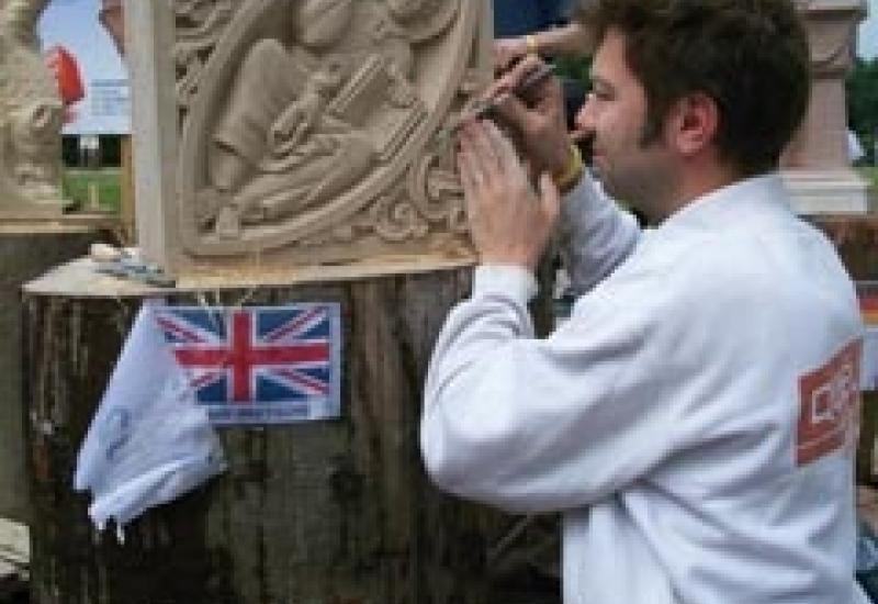 Alex Wenham during the European Stone Festival working on his prizewinning 'Christ in mandorla', inspired by work he had seen at Ely Cathedral.