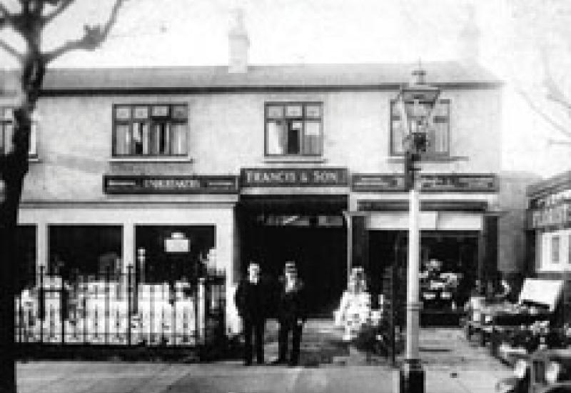 The father and grandfather of David Francis outside the family firm about 1920.