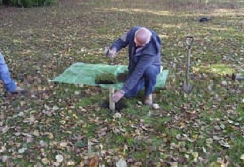 Anton tries driving a sharpened 50mm wooden steak into the ground with a 5kg hammer at Towcester Road cemetery.