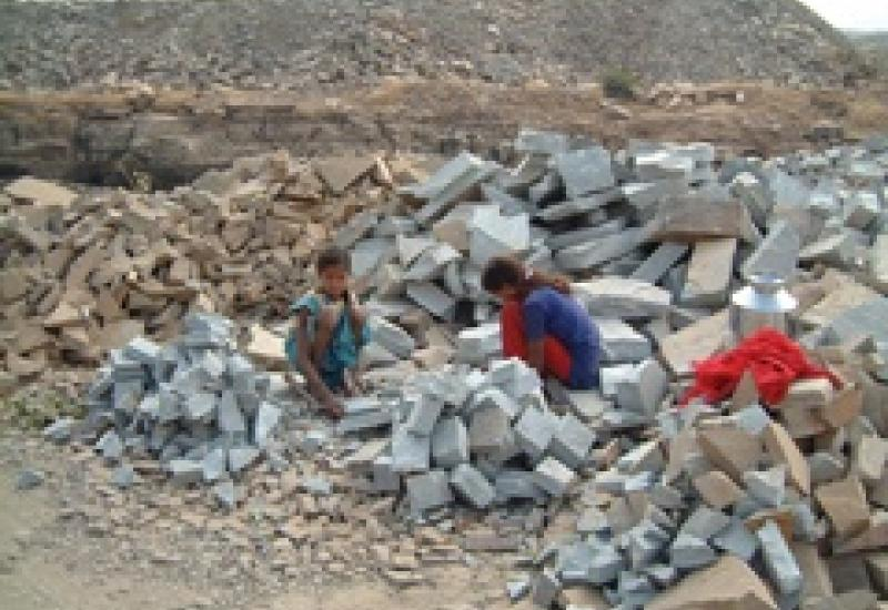 An ETI photograph showing children working in a sandstone quarry in India.