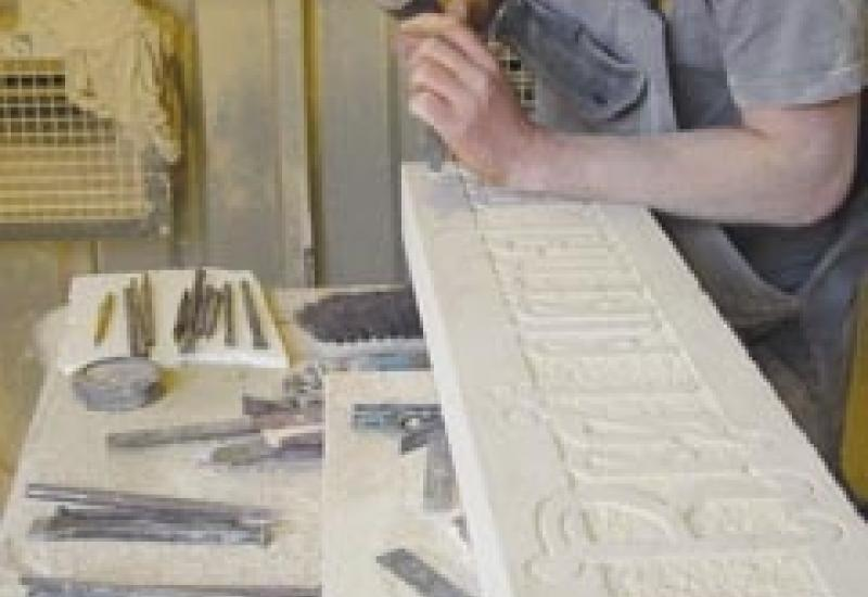Before Alex Williams could start cutting this 132-letter inscription in Clipsham stone he had to recreate the Gothic alphabet used on the original.