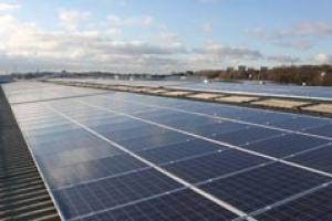 Generating interest: an array of photovoltaic cells on a warehouse roof.