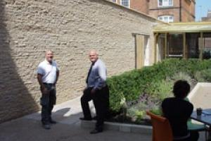 Paul Leivers (left) from contractor Amici and John Coop from Realstone in front of the Ancaster perimeter wall at the new Richard III visitor centre.