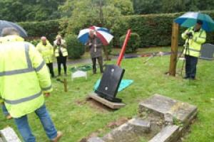 The pin memorial fixing system is pulled from the ground on a rainy September day in Redhill.