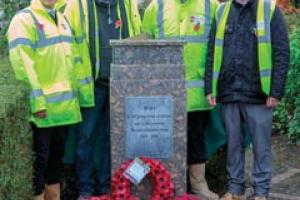David Collier, Jez Greeves, Andy Gravil, Gareth Townend with teh memorial sundial they made and installed.